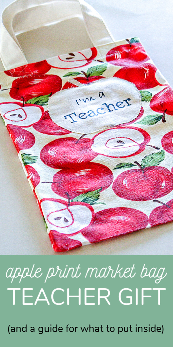An apple print market tote bag for teachers including a guide for what to put into the bag