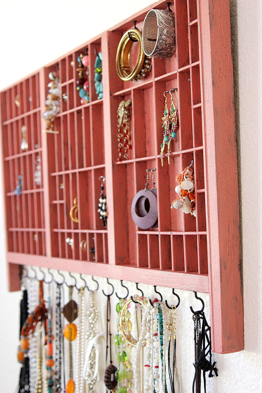 DIY wall jewelry organizer from a printer's typeset drawer.