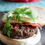 burgers stuffed with gorgonzola and bacon and topped with grilled pear