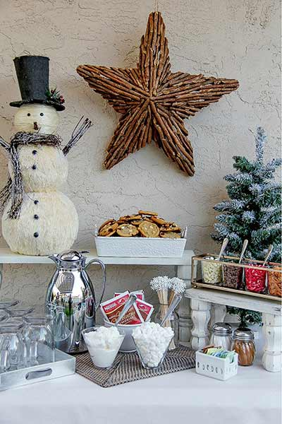 a Christmas hot cocoa bar with topping ideas and supplies