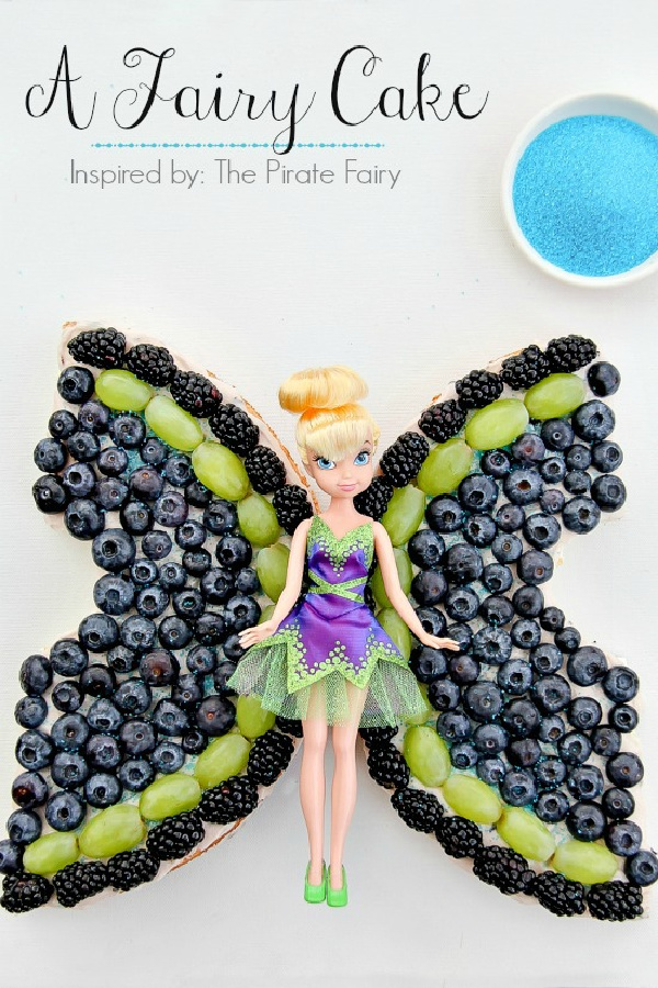 an angel food cake topped with fruit that looks like fairy wings