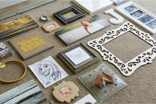 items for a gallery wall being sorted