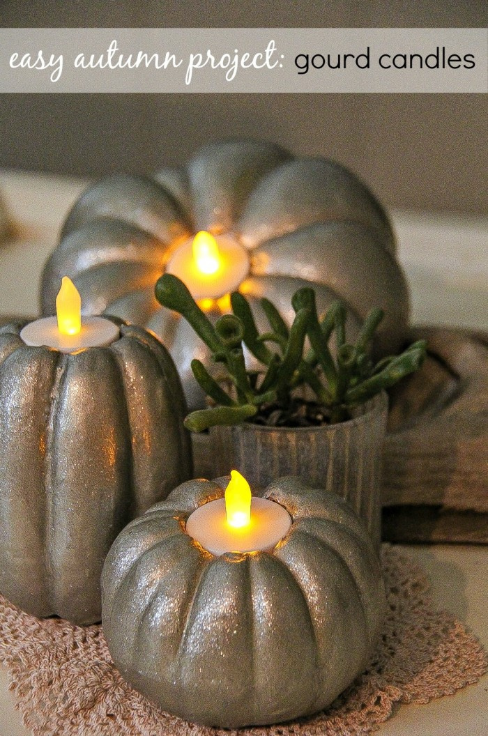 foam pumpkins and gourds painted silver with tealight candles inside them