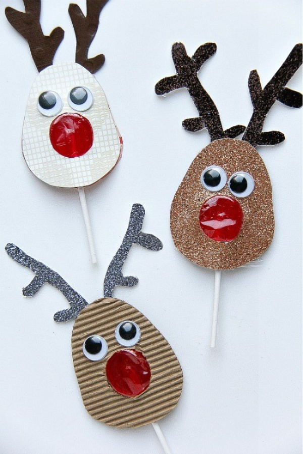 red lollipops with a paper reindeer sleeve over them