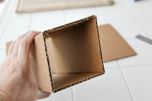 a box folded into a tunnel