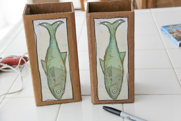 fish pictures stuck onto cardboard boxes
