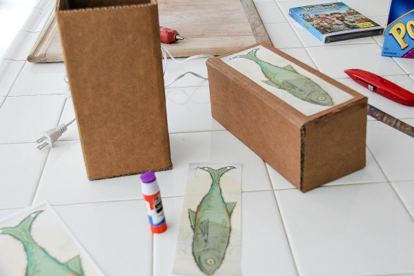 a fish printable being stuck onto a box