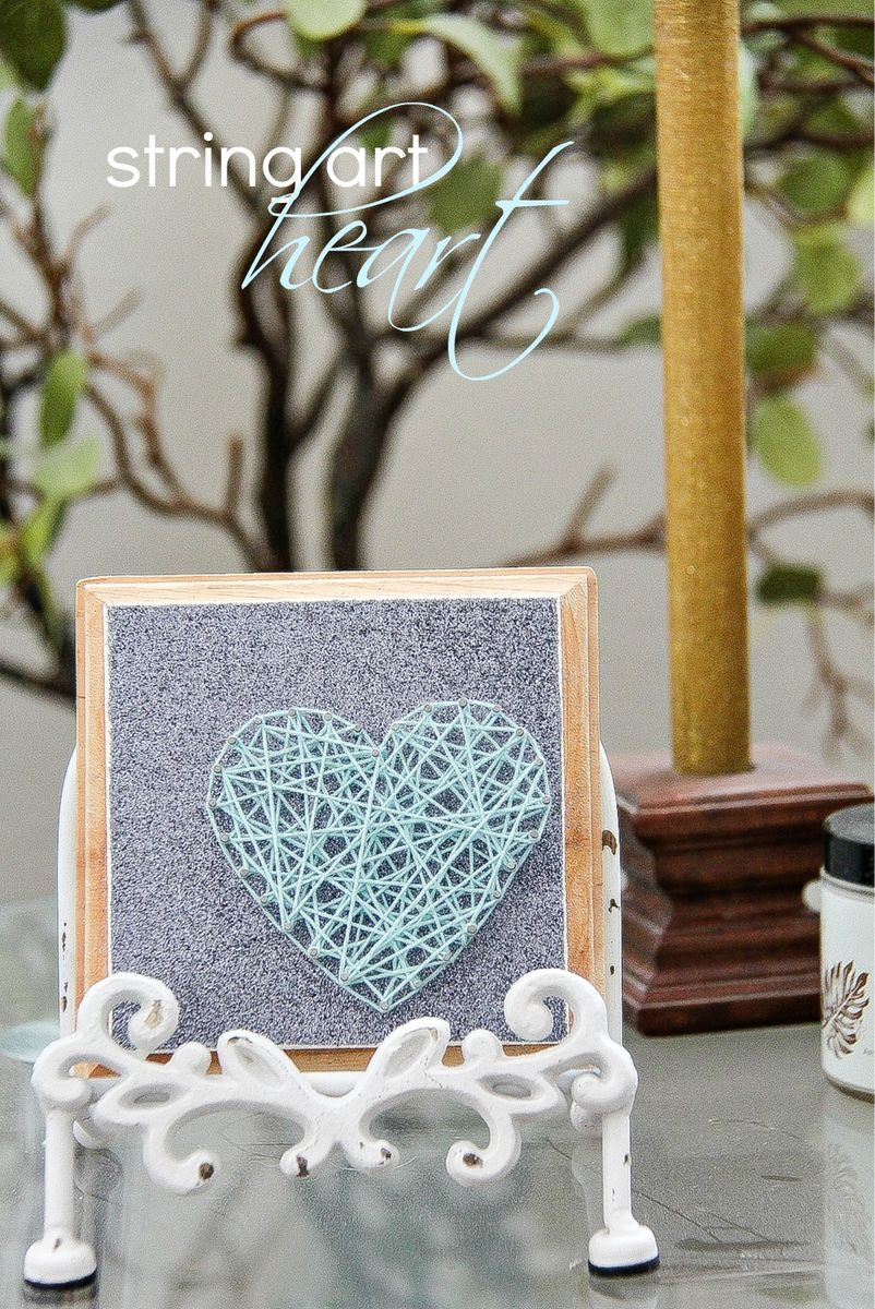 small string art heart on silver paper and wood