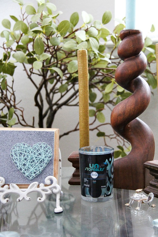 string art and candles on a table