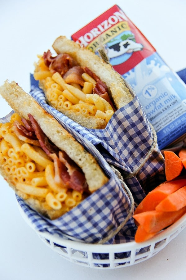 bacon mac & cheese sandwiches, milk box, and carrots in a food container
