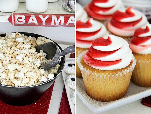 popcorn in a black bowl and red and white frosted cupcakes