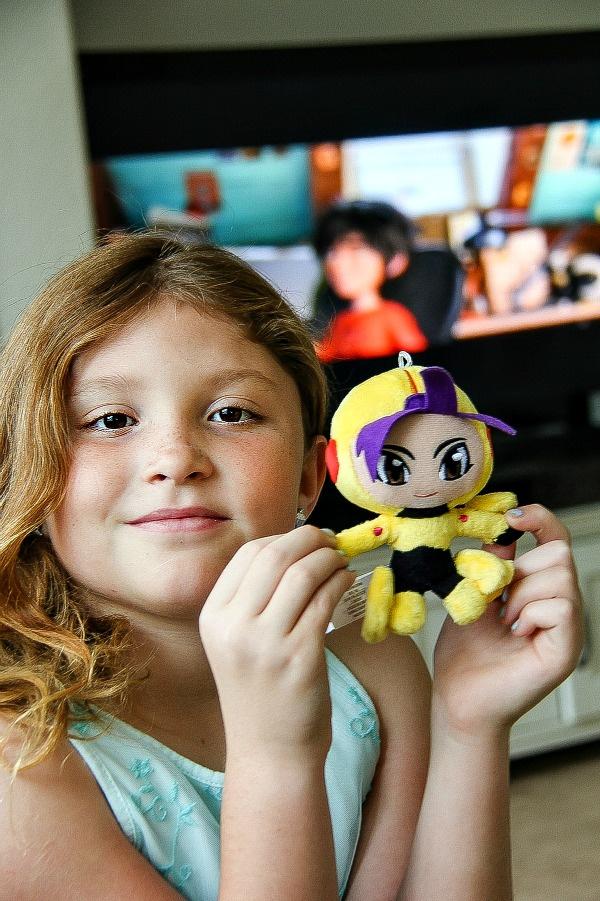 girl holding a big hero 6 plush doll