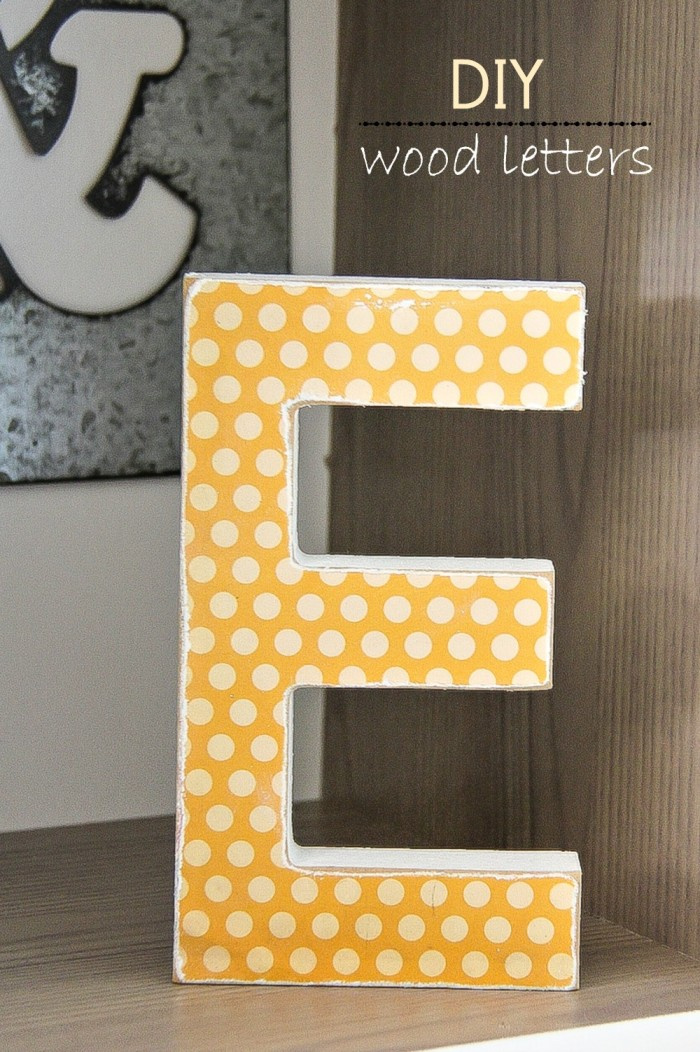 a wood letter with scrapbook paper over the top