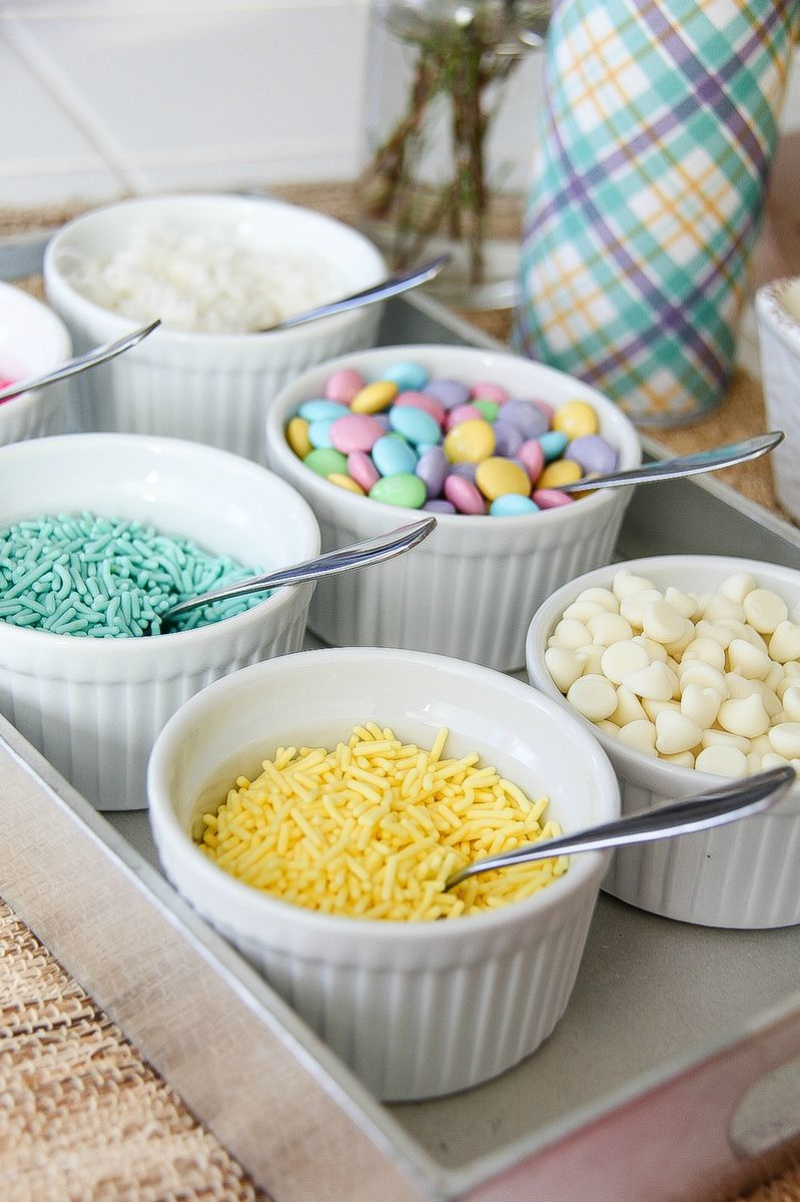 pastel candies and toppings in white bowls