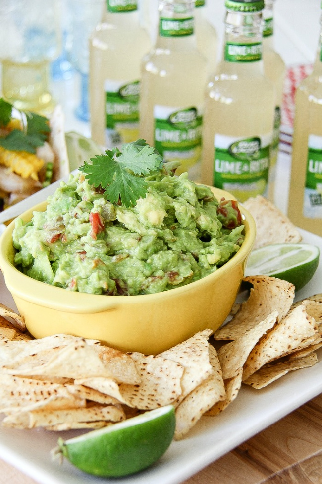 guacamole in a yellow bowl with corn chips