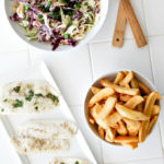 baked fish with chips and coleslaw