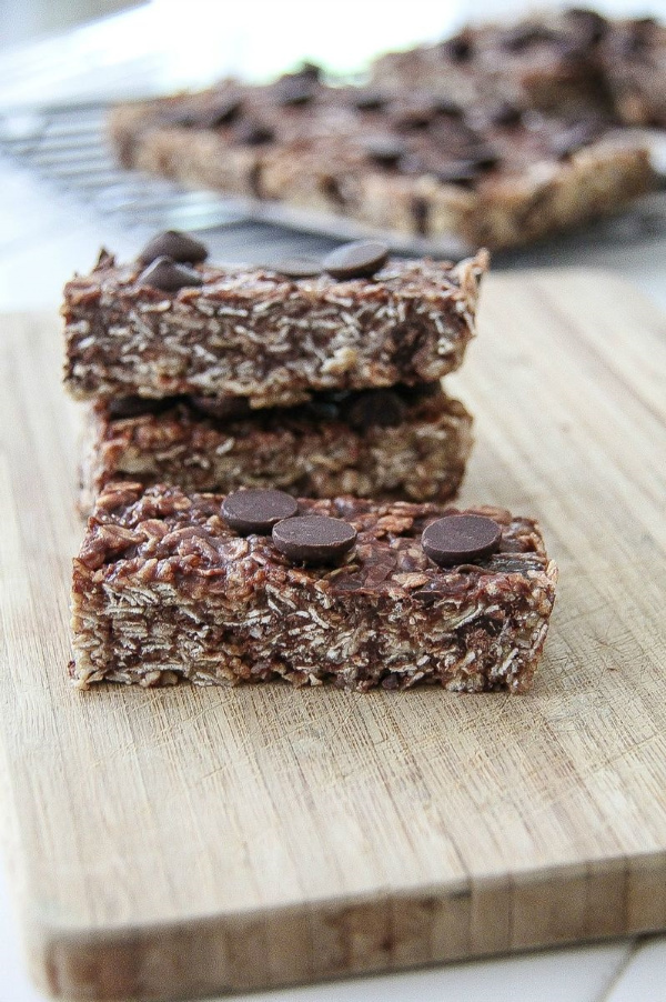 homemade granola bars cut into rectangles on a cutting board