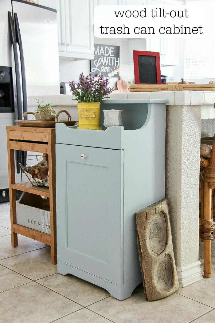 grey wood trash can cabinet in a kitchen