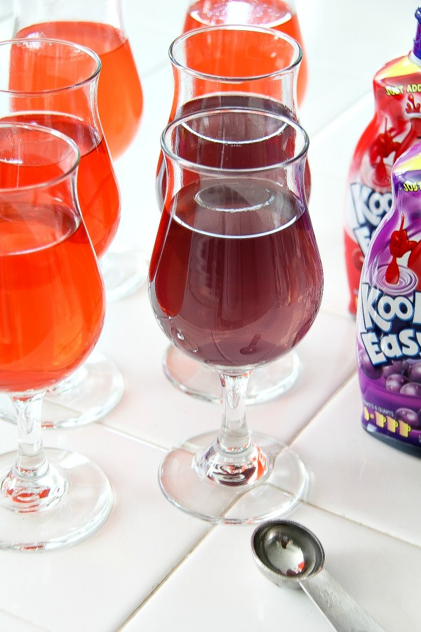 grape and cherry kool aid in glasses