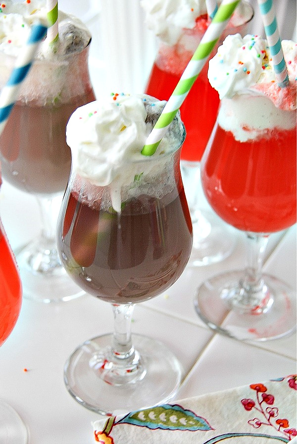 ice cream floats in a glasses with paper straws