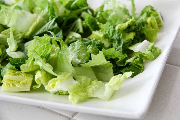 lettuce on a white serving tray