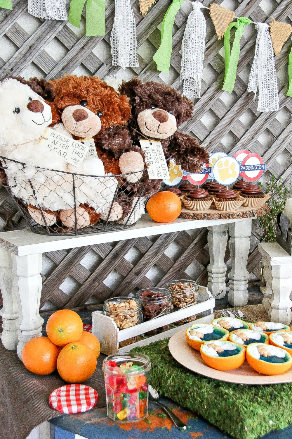 teddy bear party table with snacks and stuffed bears