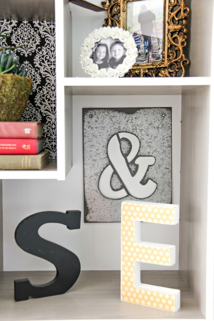 square shelving with wood letters