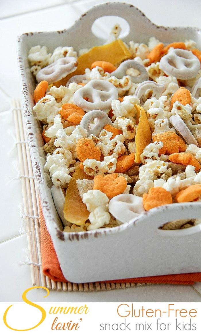 yellow orange and white gluten-free snacks in a white ceramic bowl