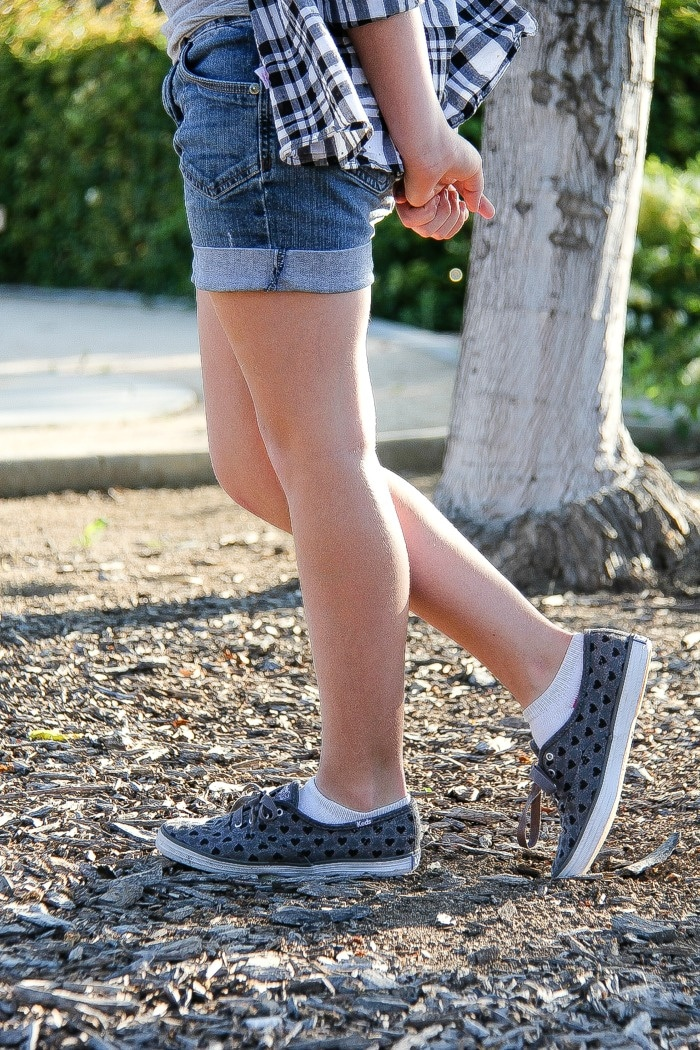 girl wearing shorts and grey and black shoes