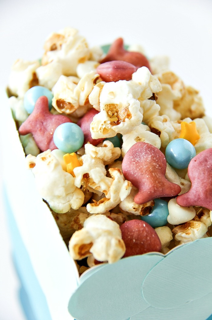 snack mix for kids for an under the sea party with pink goldfish, popcorn and blue bubble candy