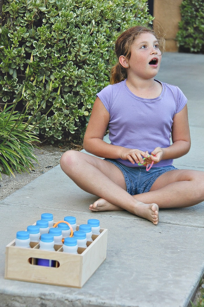 a girl playing ring toss