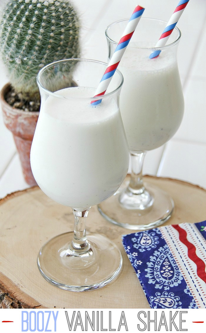 a vanilla milkshake with red white and blue straw and napkin