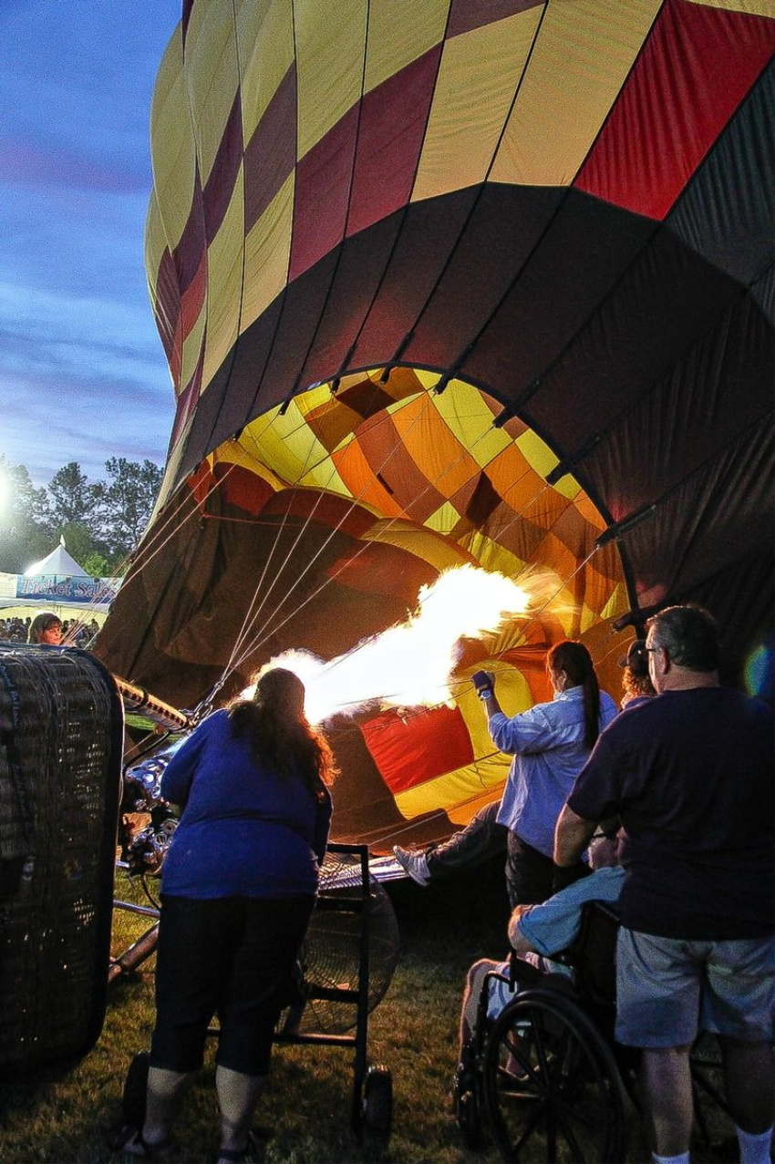 inflating of a hot air balloon after dark