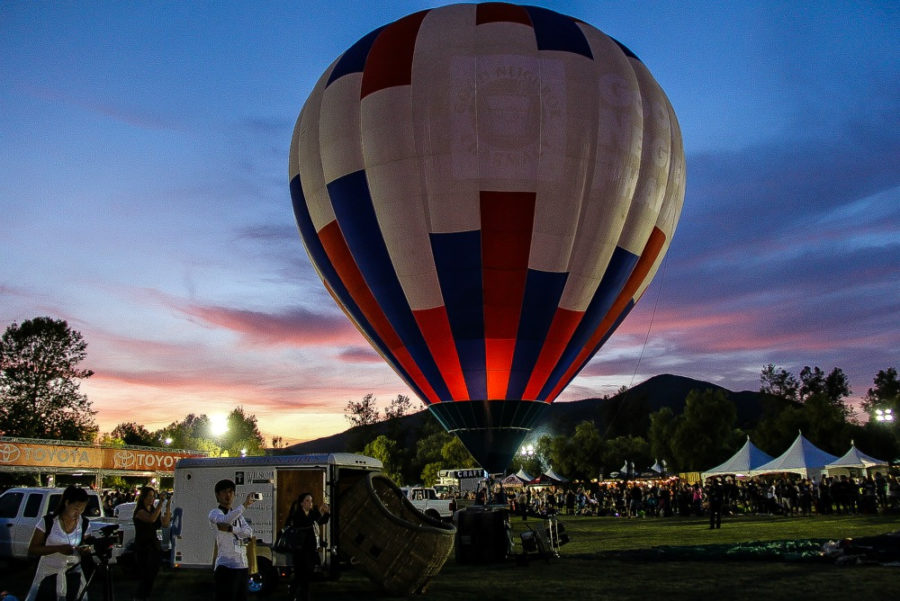 hot air balloon inflated at sunset