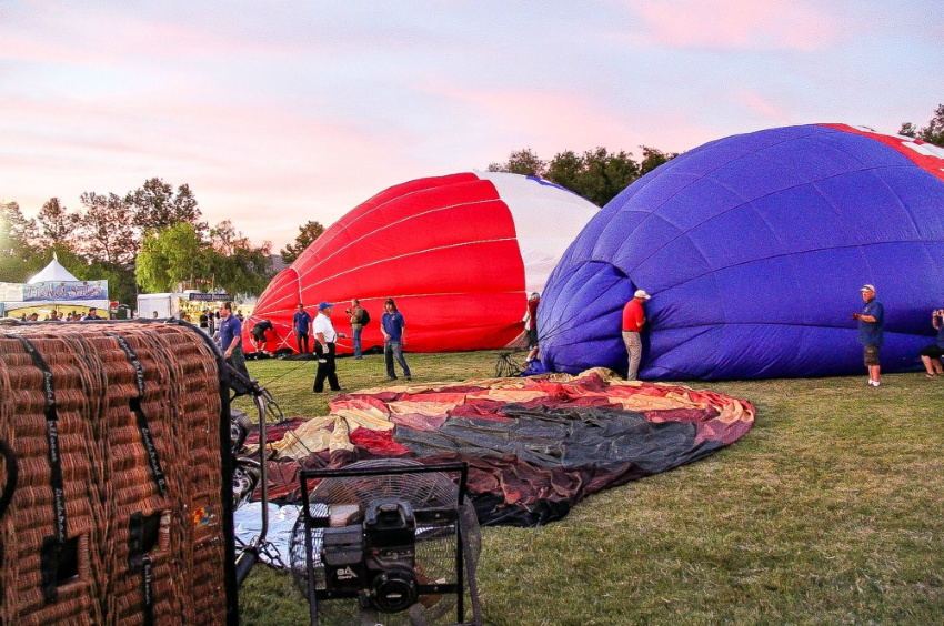 hot air balloons on the ground waiting to be inflated