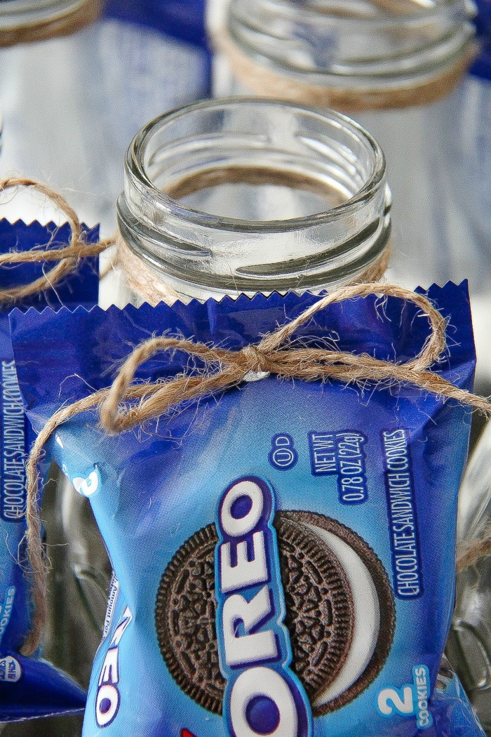 hole punched in oreo bag of cookies and tied to a milk bottle with string