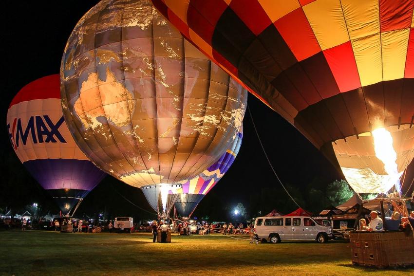 a world globe hot air balloon at night