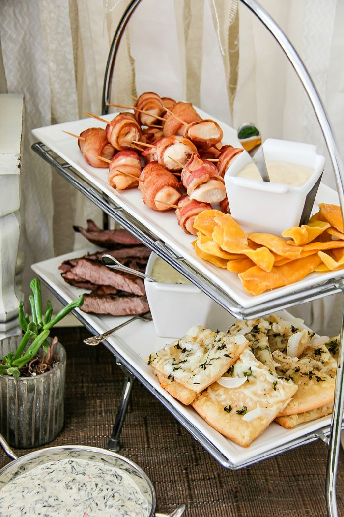 party appetizer tiered trays with bacon, beef, pizza, and dried fruit
