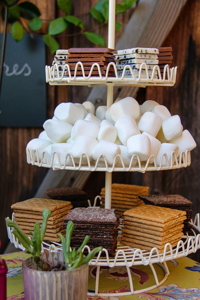 graham crackers, marshmallows, and chocolate in a cupcake stand for smores