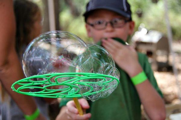 boy using a plastic bubble maker