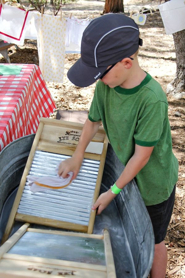 boy washing a cloth on a board