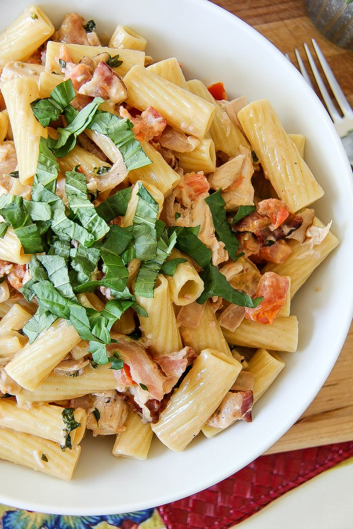 rigatoni pasta with bacon, chicken, tomatoes and basil