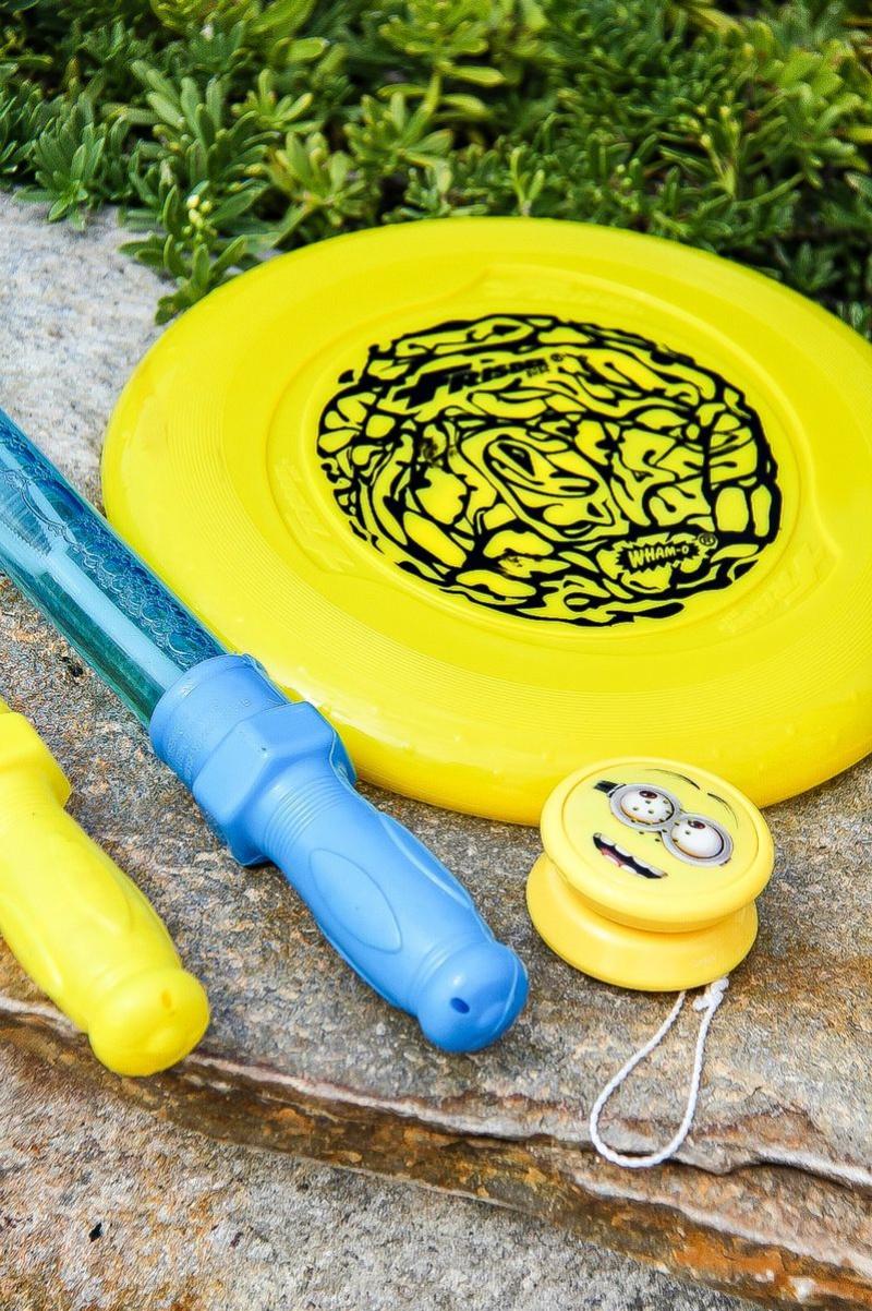 yellow and blue frisbee, bubble wands, and yo-yo's
