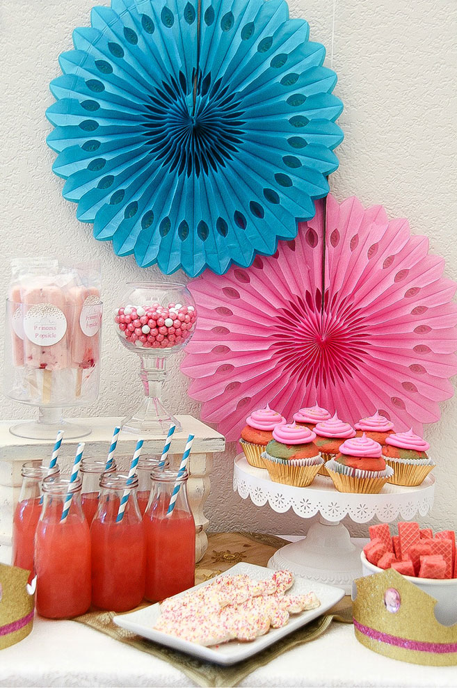 pink and blue party table with lemonade, cupcakes and candy