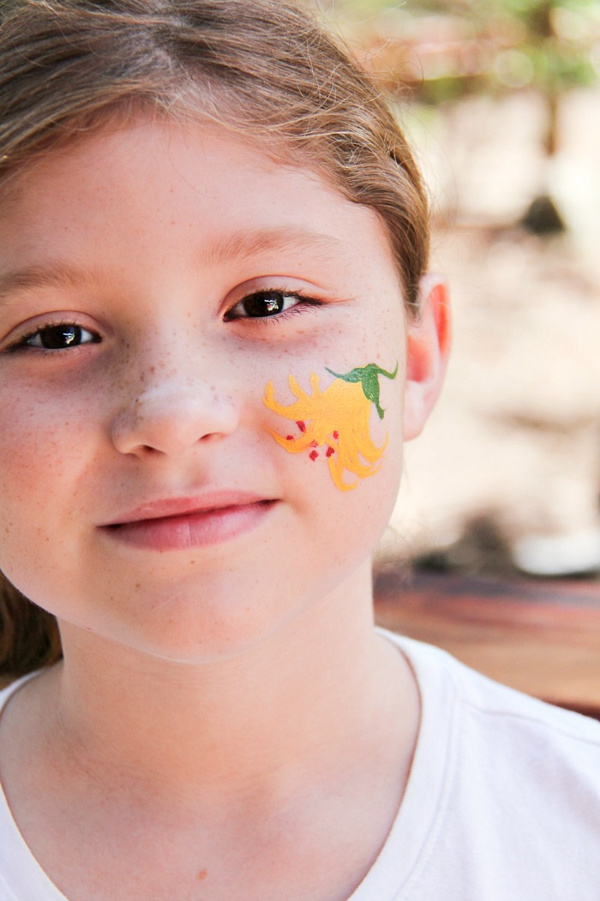 lemon lily painted on a girls face