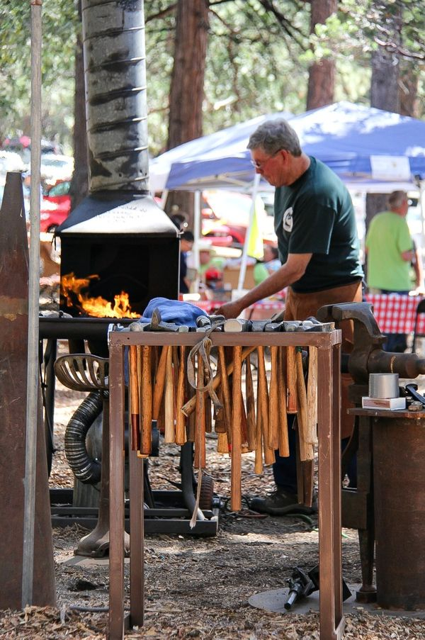a blacksmith at work at a festival