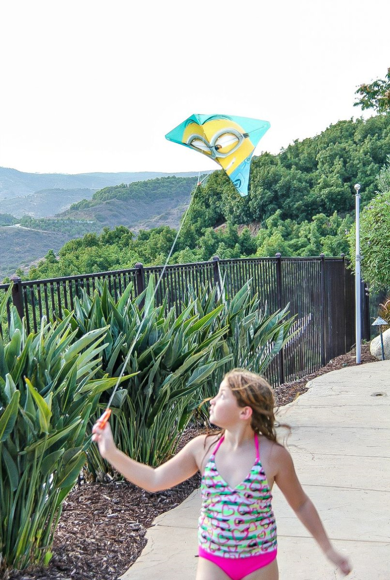 girl flying a minions kite