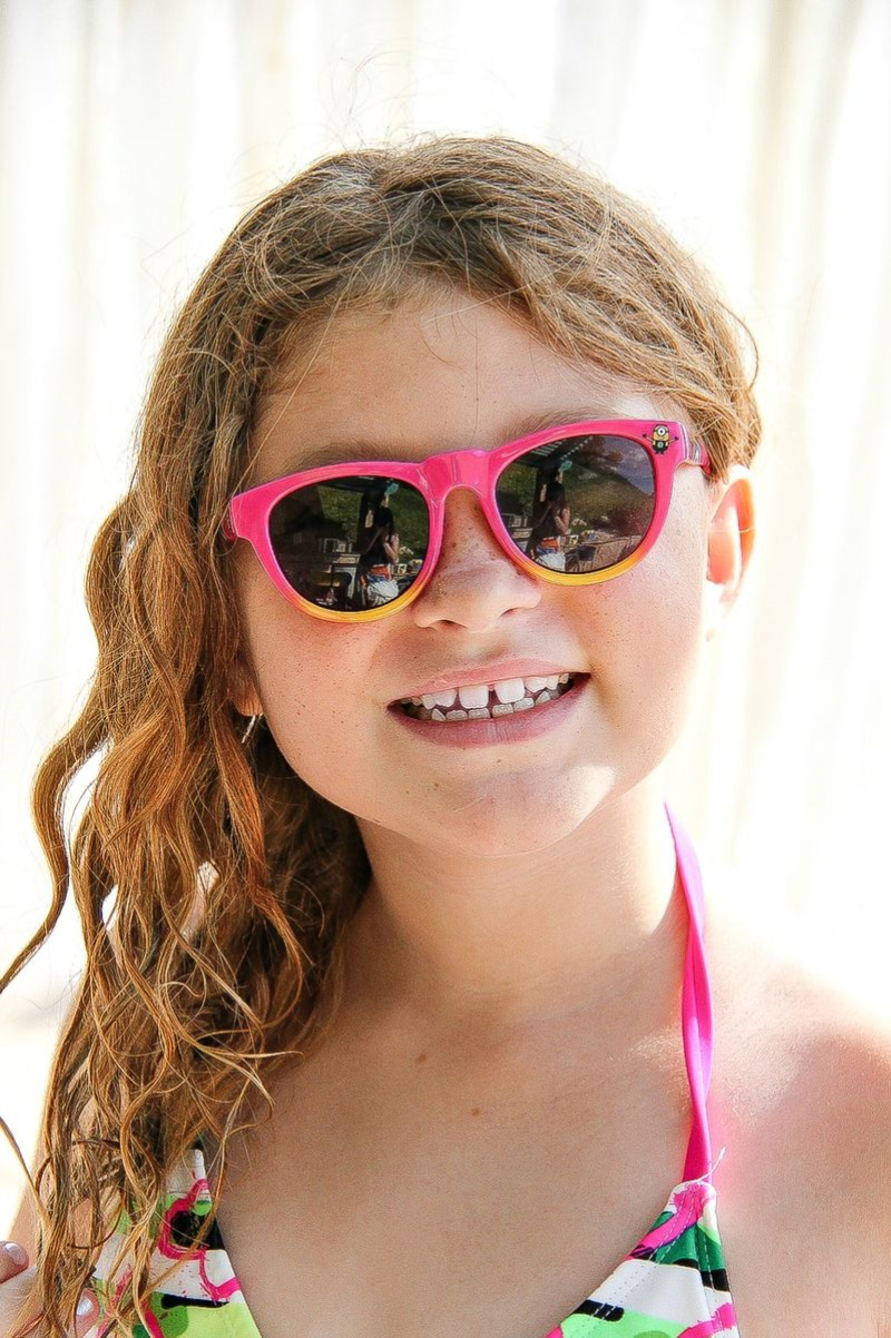 a girl wearing despicable me pink sunglasses