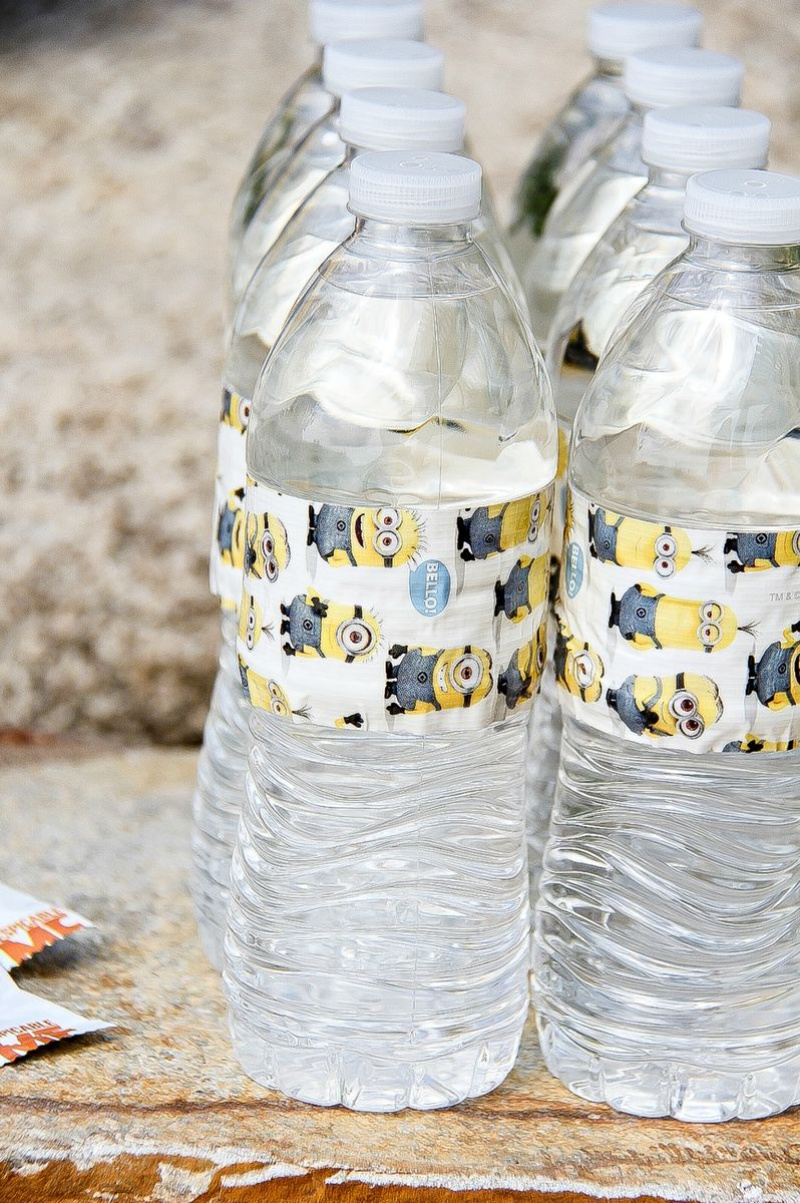 water bottles with minions tape wrapped around them