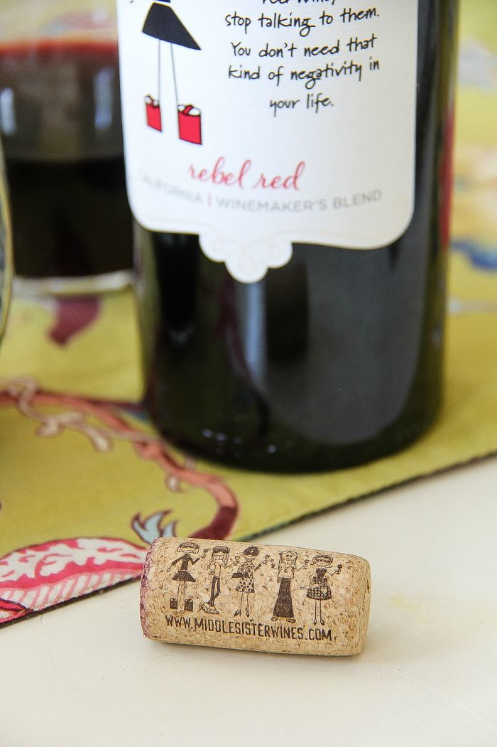 Middle Sister wine cork in front of a bottle of Middle Sister Rebel Red